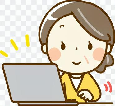 Senior woman operating a personal computer
