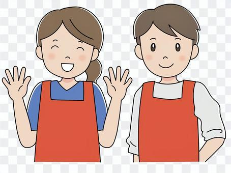 圍裙的男性和女性員工