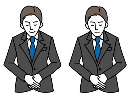 A man in a business suit bowing