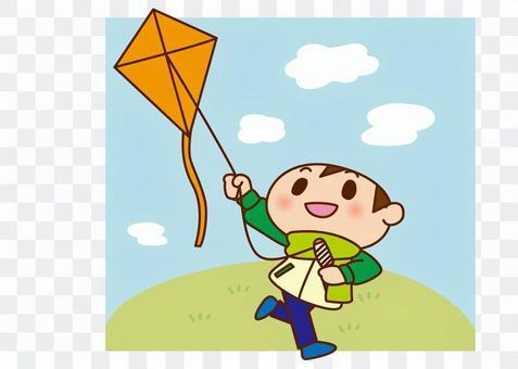 A boy kicking a kite