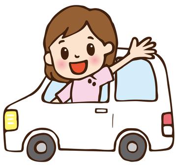 Female nurse heading for home-visit nursing in a car