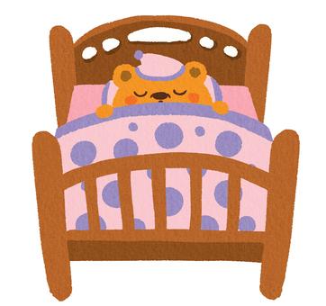 Bear sleeping in bed