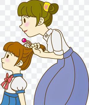 連接女兒頭髮的媽媽