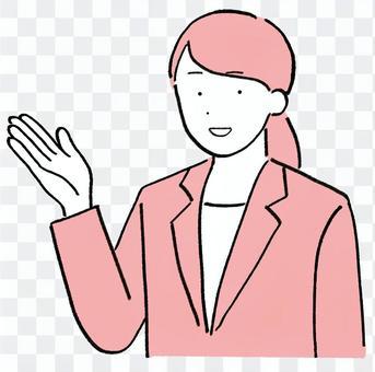 一個穿著西裝的女人舉起一隻手