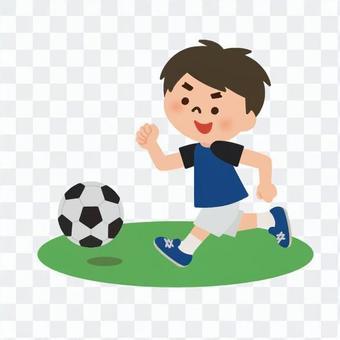サッカーを楽しむ少年