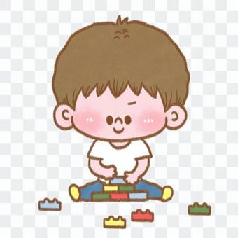 一個男孩玩積木的插圖