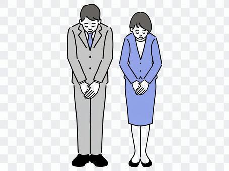 Businessmen and businesswomen bowing