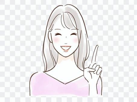 一個美麗的微笑女人指著