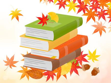 Autumn leaves, books and acorns