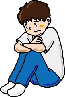 Boy holding knees