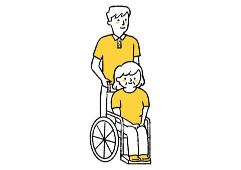 推著輪椅的男人