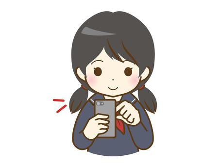 操作智能手機的女學生