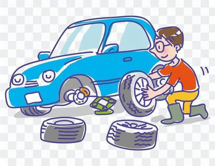 一個男人在一輛藍色的汽車上更換輪胎