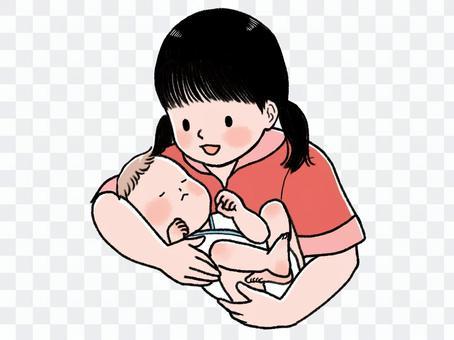 孩子抱著一個嬰兒
