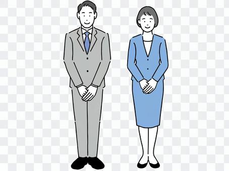 Male and female office workers standing with a smile