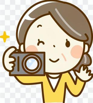 Senior woman holding a camera