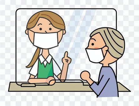カウンターのアクリル板とマスク女性2人