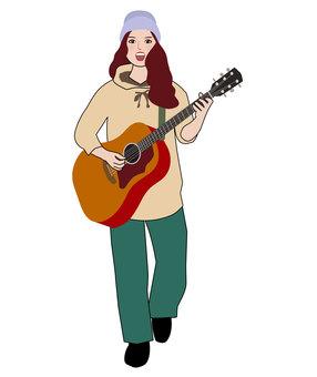 彈吉他和唱歌的女人