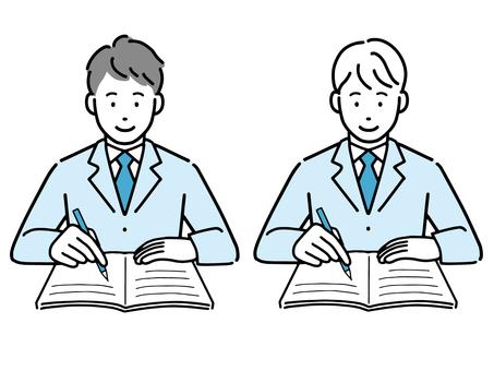 男學生在課堂上做筆記
