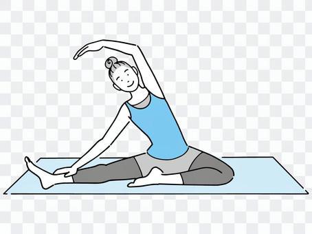 在瑜伽墊上做瑜伽的女人
