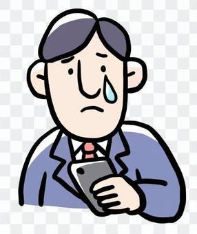 一個男人在哭與智能手機