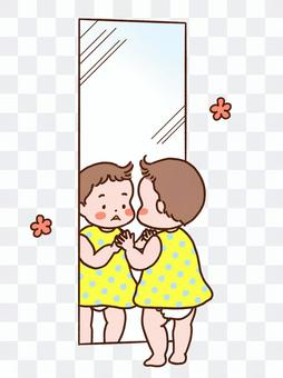 Child looking in the mirror