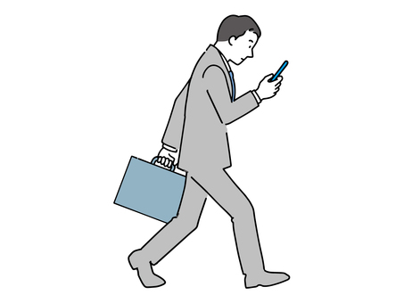 Office worker walking while looking at a smartphone