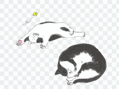 寝ているぶち猫