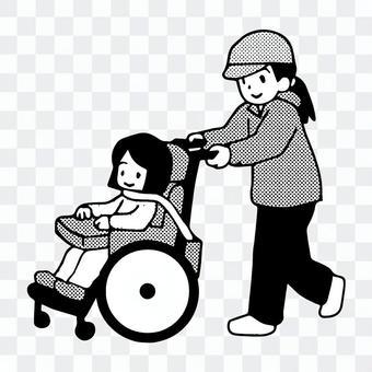 車椅子で移動する子供と先生。または母親