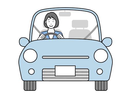 駕駛汽車的女商人