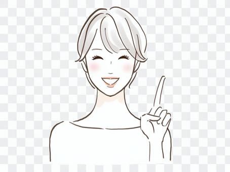 Beautiful smiling woman pointing