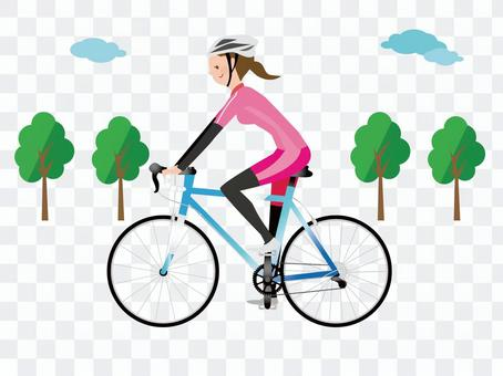 一個女人騎著公路自行車