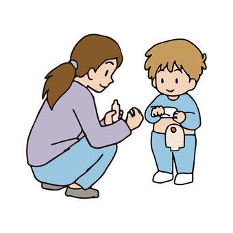 母親為孩子的造口更換支具