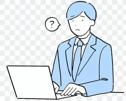 一個穿西裝的男人在電腦前思考