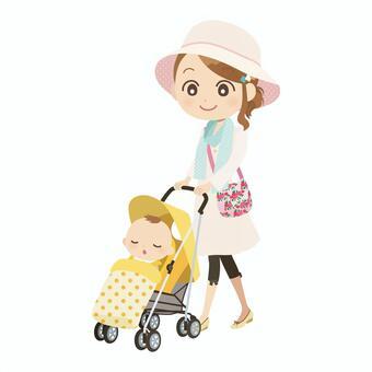 一个女人漫步的婴儿车