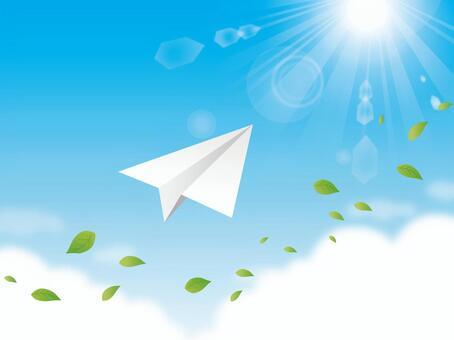 用樹葉和陽光和紙飛機背景的天空