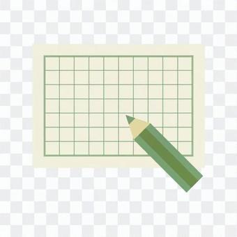 稿紙和綠色鉛筆