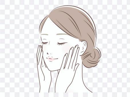 一個微笑的女人,用她的手在她的臉頰上
