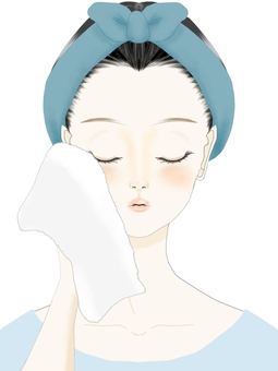 A woman pressing a towel against her face