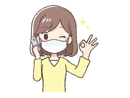手機ok標誌便衣女士面罩上身