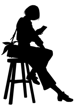 A woman sitting on a chair and operating a smartphone