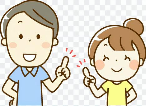 微笑的男人和女人在指向姿勢