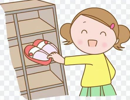 把鞋子放的孩子在鞋盒