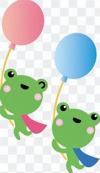 附著在氣球上飛翔在天空中的青蛙
