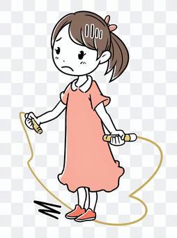縄跳びを失敗する子供・女の子