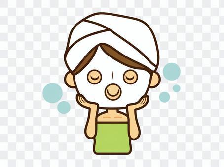 フェイスマスク、パックで保湿する女性