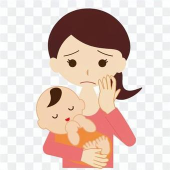 Mom holding a baby with a troubled face