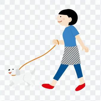 A woman walking a dog