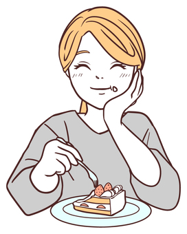 Woman eating cake with a smile
