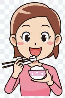 一個女人在吃米飯